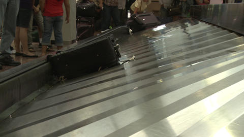 Luggage on the baggage claim conveyor Live Action