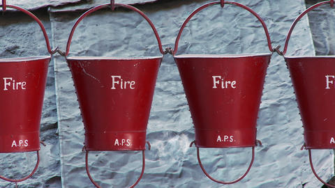 Several fire buckets hanging on hooks Footage