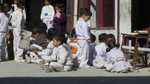 School children in uniforms sitting and walking with books Footage
