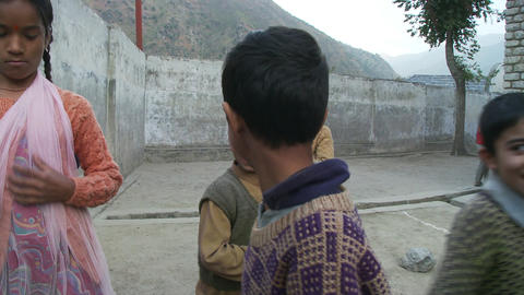 Young boys and girls outside laughing and playing Footage