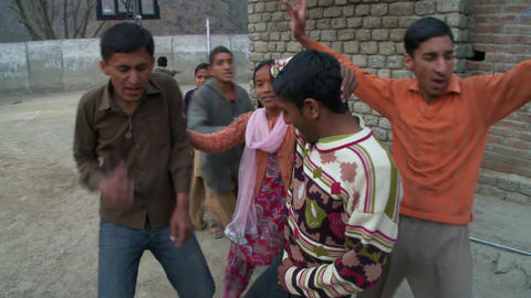 Teenage boys and girls dancing outside Footage