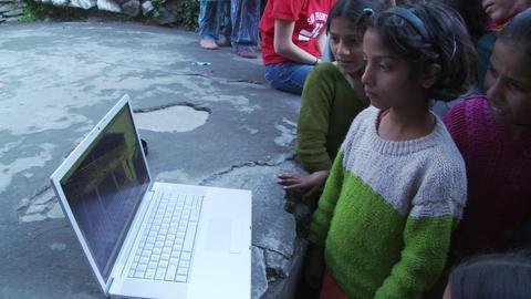 school girls watch laptop Live Action