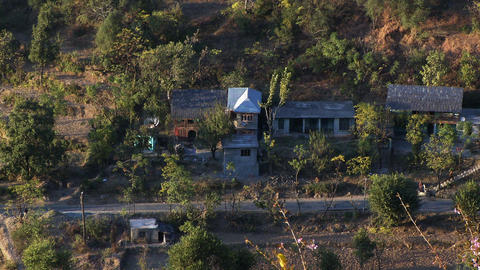 Static shot of several homes in rural Indian area Footage