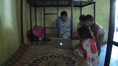 Children watch apple laptop on bunkbed Live Action
