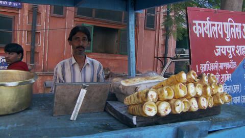 Man selling treats on street Footage