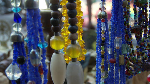 Necklaces on stand at shop in India Footage