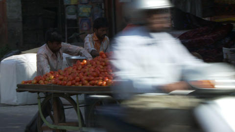 Two men pushing tomato cart Footage