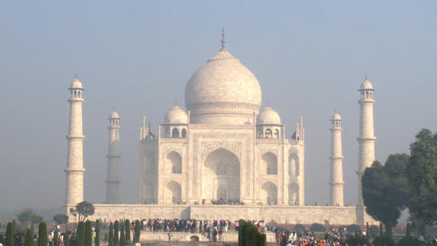 Static shot of the Taj Mahal and many people visiting Footage