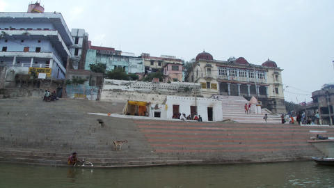 Shot of several buildings from a boat on the Ganges river, India Footage