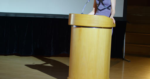 Young Caucasian businesswoman speaking on stage in auditorium 4k Live Action