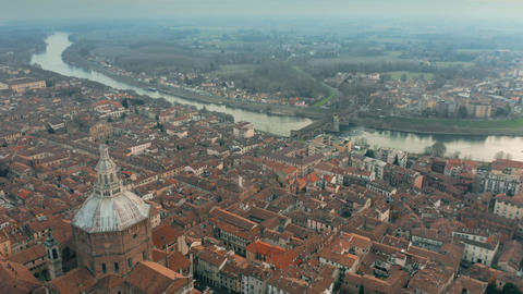 Aerial shot of Duomo di Pavia cathedral and the Ponte Coperto Bridge within the Footage