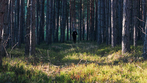 Young man run in forest from front Footage