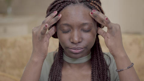 Portrait nervous african american american woman with dreadlocks massaging her Footage