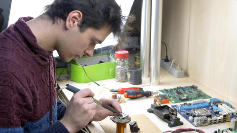 Student repair of electronic devices in electronics workshop Footage