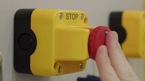 Finger pressing stop button, hand reset emergency signal Live Action