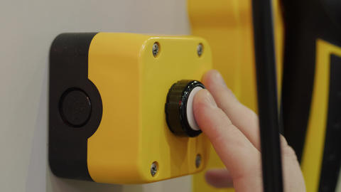 Pressing button on manufacture, reflection of blinker unit Live Action