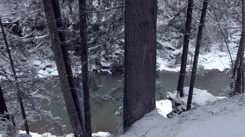 Fairytale stream seen from a steep slope in the Carpathians in winter in slo-mo Footage
