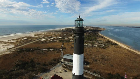 Lighthouse and Shoreline Close Up on a Sunny Winter Day as Seen by a Drone Live Action
