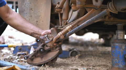 Hands of mechanic spining nut and bolt for loosen and tighten truck wishbone control arm 002 Footage