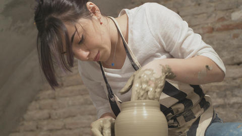 Beautiful girl sculpts a clay pot Stock Video Footage