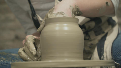 Close-up of potter makes a earthen clay jag Stock Video Footage