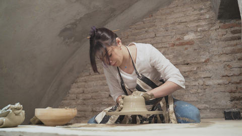 Girl potter works with clay Stock Video Footage