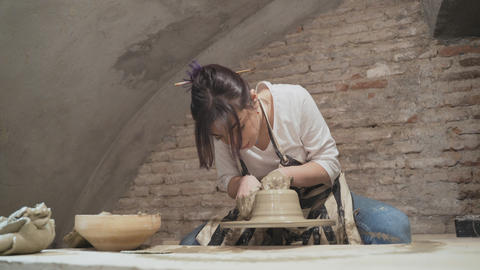 Girl potter works with clay, Live Action