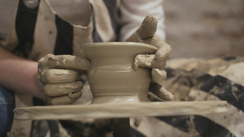 Potter creating a clay jar Footage