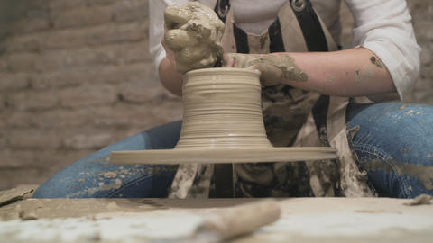 Potter's hands makes a pot- Close Up Shot Live Action