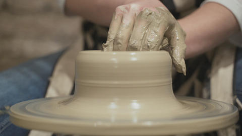 Potters hands sculpts the pot Stock Video Footage