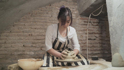 Young woman makes a clay pot Stock Video Footage