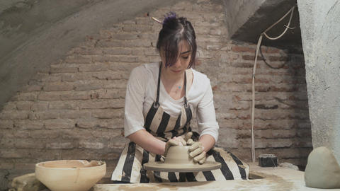 Young woman makes a clay pot Footage