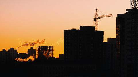 Cranes working on construction site residential constructors working golden hour Footage