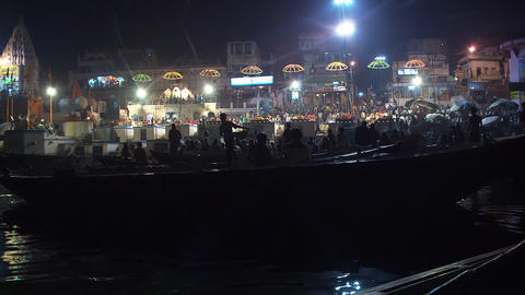 Nighttime shot of boats along the Ganges river shoreline in India Footage