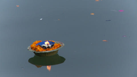 Flower candle floats on ganges river Footage
