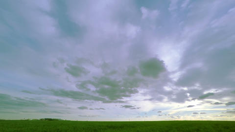 Cloudy Sky over the Green Field Footage
