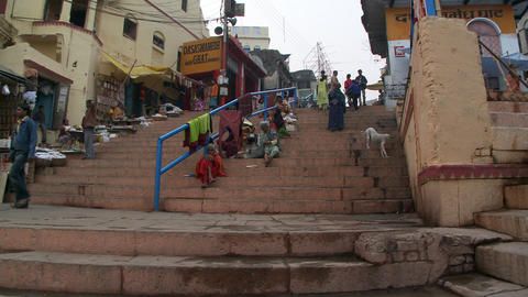Shot of foot traffic on some steps in an Indian town Footage