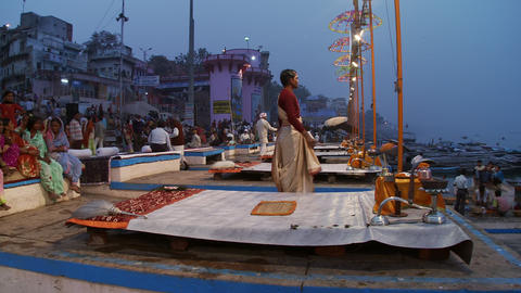 Evening incense offering to the Ganges on the wharf in an Indian town Footage