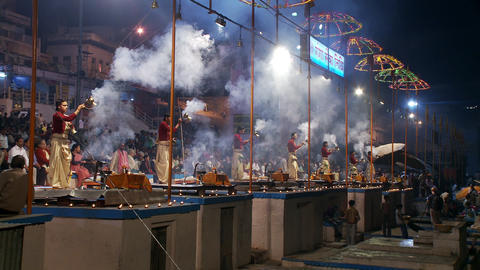 Several men swinging incense burners, making an incense offering to the Ganges r Footage