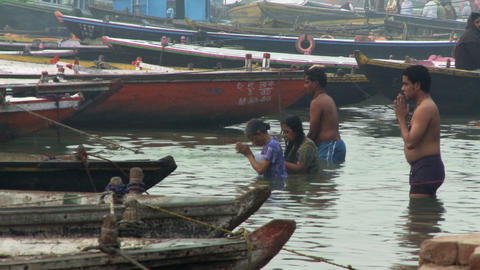 Praying in Ganges river Footage