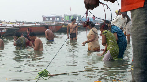 People bathing in the Ganges river Footage