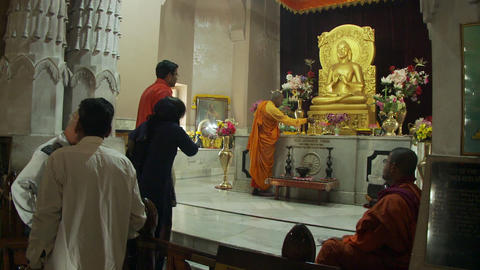Interior of buddhist temple withe moms and worshipers Footage