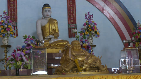 Buddha statue in Buddhist Temple Altar Live Action