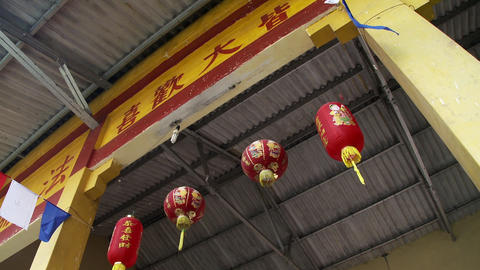 Chinese lanterns hanging below a sign in Chinese Footage
