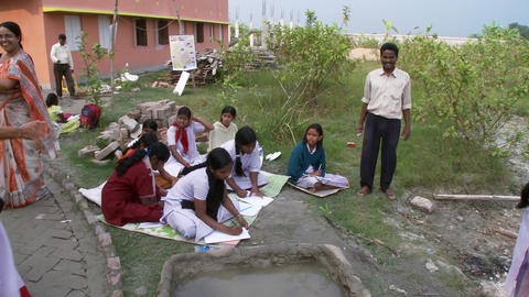 Girls doing school assignment on blankets Live Action