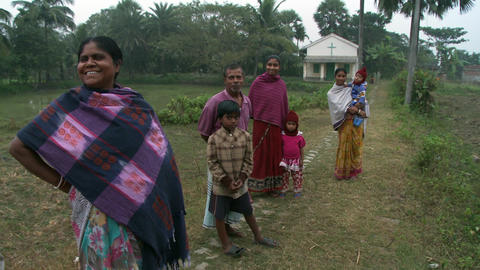 Indian family in a field in front of a Christian church Footage