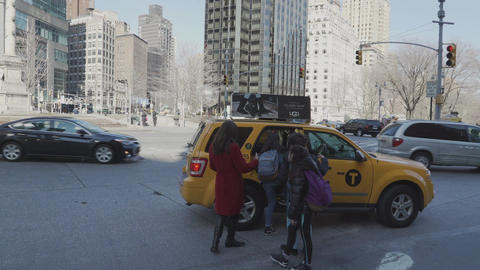 People use a taxi in New York City Live Action