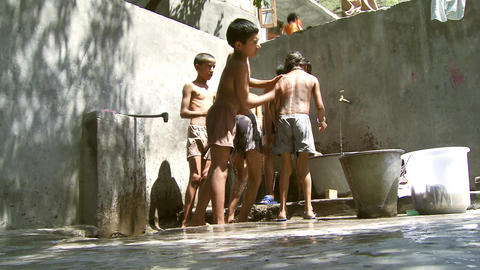 Low angle shot of boys washing Footage