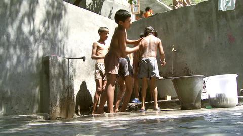 Low angle shot of boys washing Footage