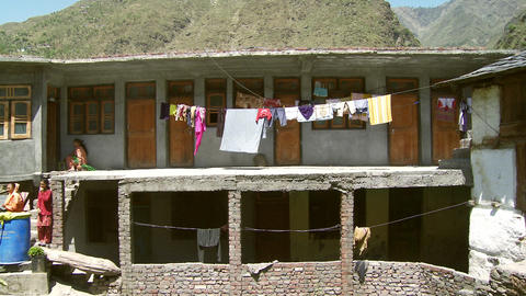 Laundry hangs from clothes line in Indian Village Footage